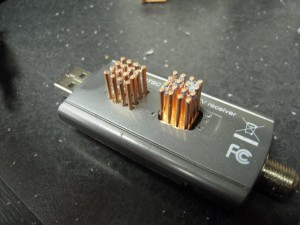 Both heatsinks through their openings - Note the per-rod holes for the second heatsink.